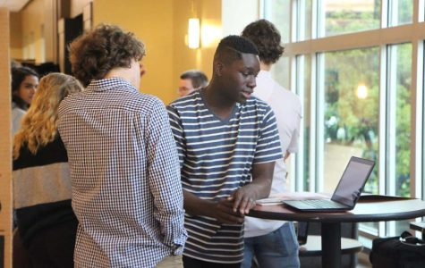 "Students finish off their final project for honors humanity by answering the question- ""what is your purpose?"" through various mediums of presentation. Through interacting with others to reflect their personal traits or get external input, or simply reflecting on their personal beliefs, students illustrated a diverse set of beliefs and projects. Pictured above: Beloved Ulinwa, senior, watches a project by one of the students that chose a multimedia presentation."