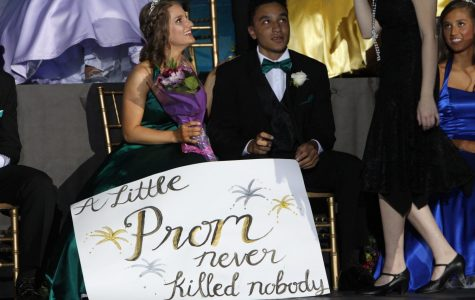 """Tristan Waits, senior, and his Promposal poster for Katie Jones, senior. The poster includes the subtitle for May Day, """"A Little Prom Never Killed Nobody."""" This reflects how the theme for both Prom and May Day are The Great Gatsby. Despite this, however, the ASB has decided to focus more on the general theme of the 1920s, which I think is a good idea."""