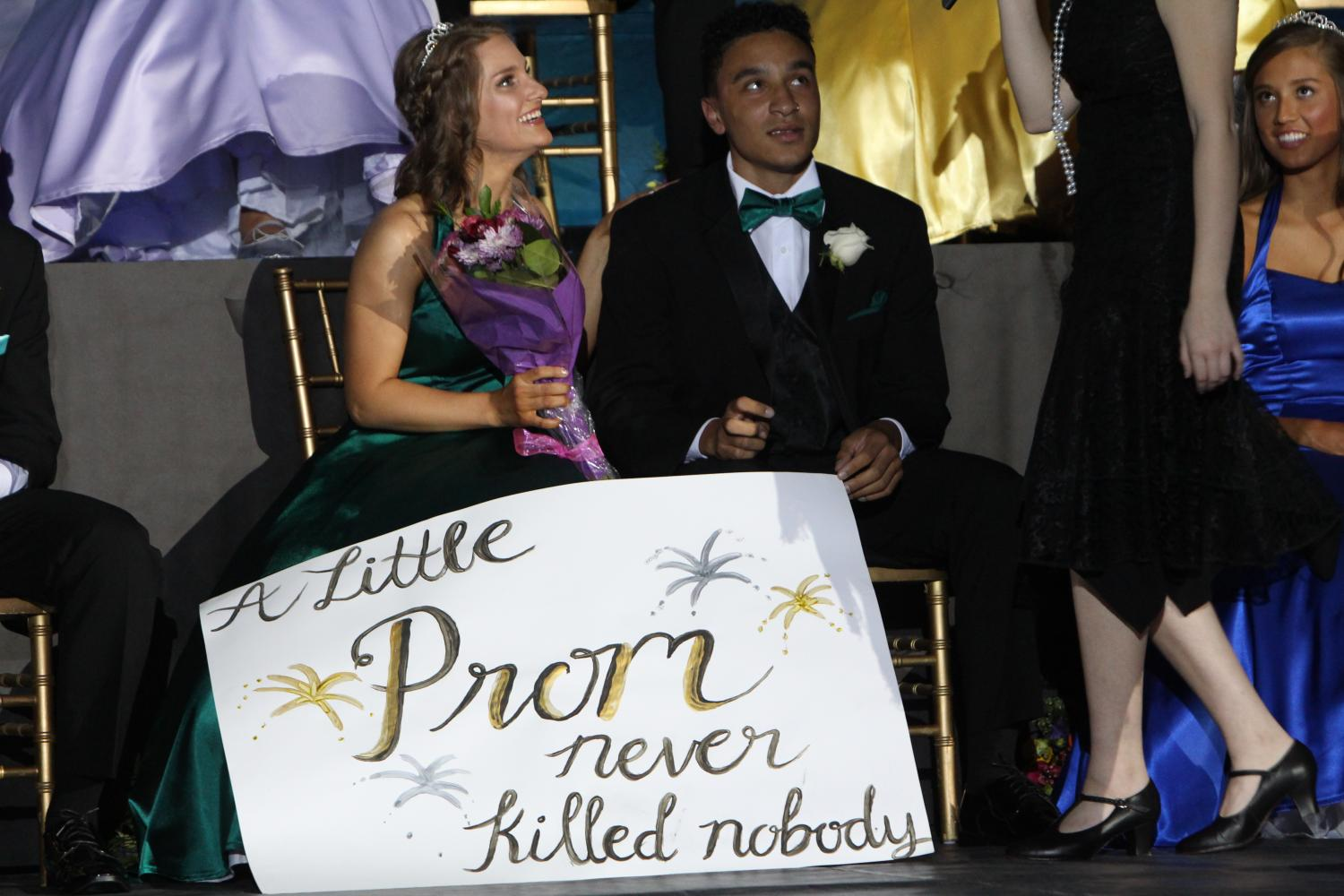 "Tristan Waits, senior, and his Promposal poster for Katie Jones, senior. The poster includes the subtitle for May Day, ""A Little Prom Never Killed Nobody."" This reflects how the theme for both Prom and May Day are The Great Gatsby. Despite this, however, the ASB has decided to focus more on the general theme of the 1920s, which I think is a good idea."