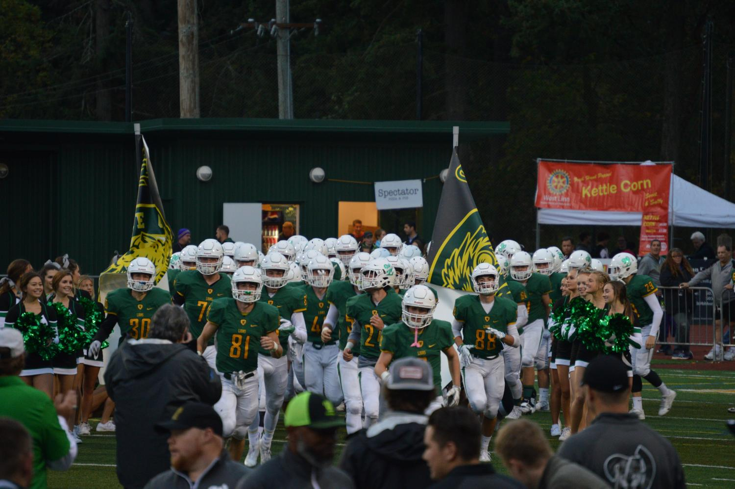 Before their blowout win against Tualatin, the team takes the field after their walk through the student section. Following the dominant victory, West Linn moves to 4-0 on the season (2-0 Three Rivers League) and Tualatin falls to 1-3 (1-1 Three Rivers League).