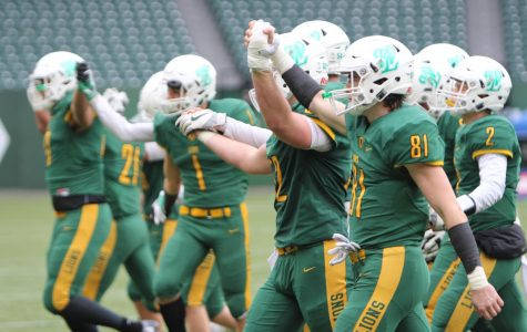 After running one last play as a team, all of the Lions' offensive starters walked off the field together for the last time. West Linn's offensive unit put up historic numbers all season en route to the Lions' first state championship in school history.