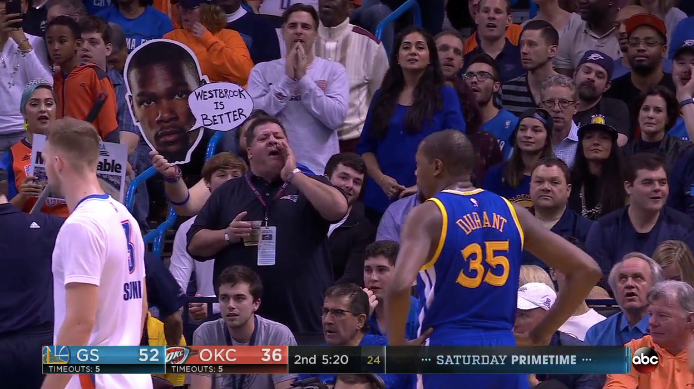 In Kevin Durant's return to Oklahoma City, fans heckle Durant with 'Cupcake' signs and 'Trader' chants from the stands.