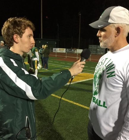 Rory Bialostosky (left) interviews Chris Miller postgame.