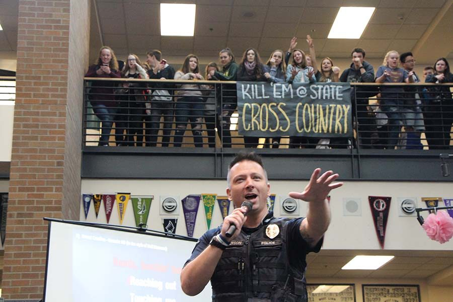 Officer Halverson, School Resource Officer, participates in Friday Karaoke. He sang
