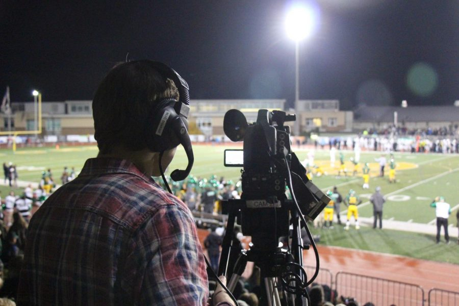 Broadcast at Work. A member of the broadcast journalism team helps to stream the game all over the country. Photo by Samuel misa