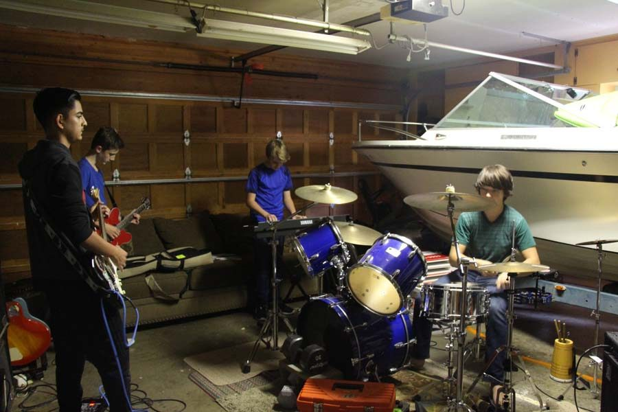 """Resistence holds their practices twice a week in Hackenjose's garage. """"My dad used to be in a band and they both love music, so they're perfectly fine with it. Honestly, my dad does his own jam sessions when they come over,"""" Hackenjose said. """"And my neighbors are completely cool with it as well."""""""