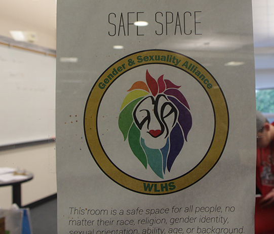 The poster frequently found in classroom windows promotes creating a free space for students to be themselves,