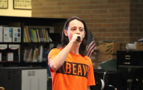 Karaoke Dec. 1 gives students the opportunity to perform songs they love. Eamon Minges, senior, performs at the senior couches.