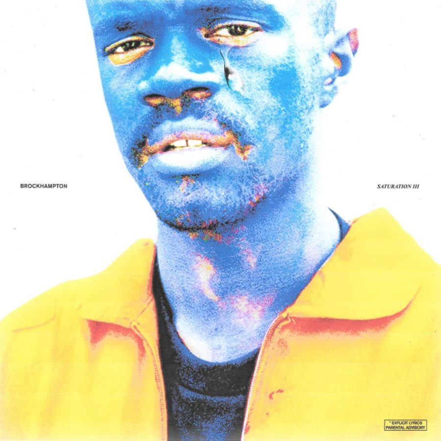 Feeling+Blue%3A+The+cover+of+%E2%80%9CSaturation+III%E2%80%9D+features+rapper+Ameer+Vann%2C+painted+blue+again%2C+similar+to+the+cover+of+the+first+%E2%80%9CSaturation.%E2%80%9D+Many+of+the+group%E2%80%99s+videos+also+feature+the+entire+group+painted+blue.+The+idea+behind+BROCKHAMPTON%E2%80%99s+repeated+use+of+blue+face+paint+is+to+give+the+illusion+of+an+over-saturation+of+color.