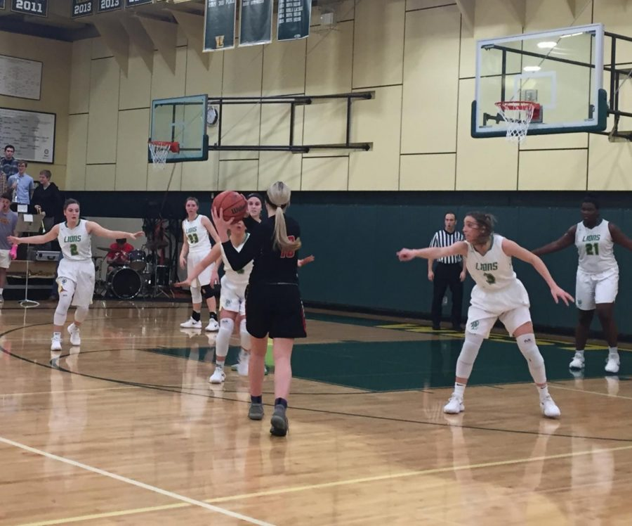 Lexie Pritchard communicates to her teammates on defense during the Lions' playoff game versus Oregon City.  Communication on defense will be a key versus North Medford.