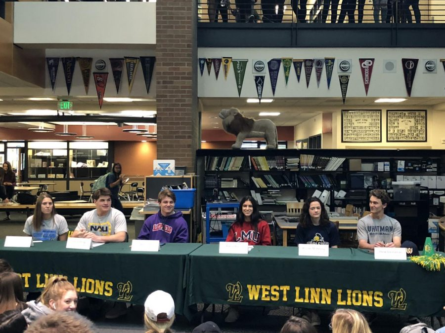 Six+senior+athletes+sign+their+National+Letters+of+Intent+to+play+college+sports+on+April+11.+The+NLI+is+a+binding+document+that+requires+one+full+year+of+athletic+participation.+