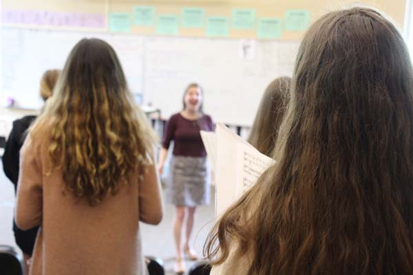 Focusing+on+the+song+%E2%80%9CI+see+the+light%E2%80%9D+from+the+Disney+movie+Tangled%2C+teacher+Aubrey+Patterson+helps+lead+her+choir+one+students+in+preparing+for+their+upcoming+performance.+Her+class+is+year+long%2C+which+often+becomes+a+problem+for+students+due+to+other+required+classes.+However%2C+this+obstacle+can+be+overcome+by+students+who+have+a+passion+too+strong+to+let+other+graduation+requirements+keep+them+from+the+electives+they+enjoy+the+most.