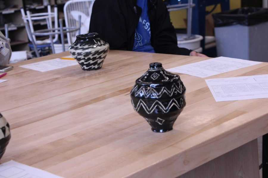 In+Ceramics%2C+Students+create+a+coil+pot+for+their+final.+The+process+involves+coiling+a+strip+of+clay+to+the+shape+of+a+pot%2C+then+smoothing+it+out%2C+and+adding+glaze.+%E2%80%9CI+found+this+design+online+and+then+used+it+because+it+was+simple%2C%E2%80%9D+Emma+Ferrario%2C+9%2C+said.+