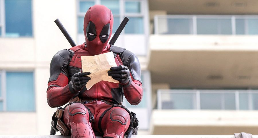 Main character Deadpool, seen in screencap above, observes a piece of paper in new installment.