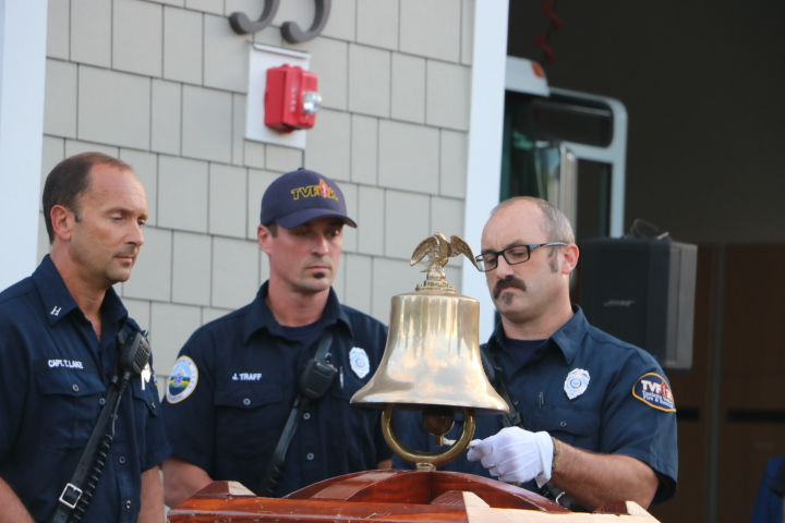 Benji Otto, a firefighter, rings the bell in a pattern that was once used to signale the loss of a firefighter.