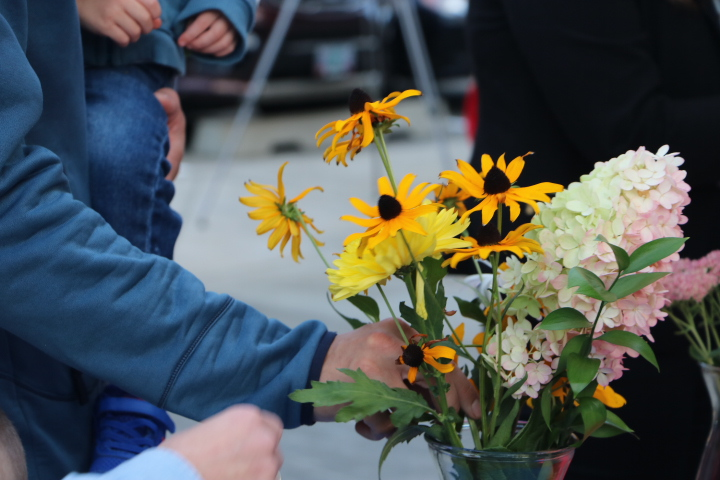 Flowers were placed by attendees, volunteers, and speakers making a bouquet in remembrance of the first responders.