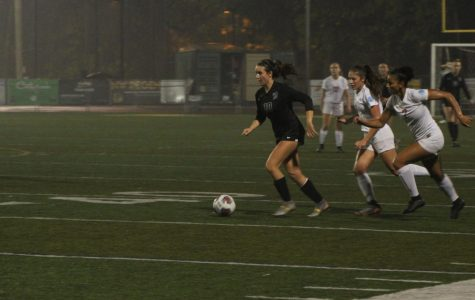 Breaking away from her competition, Caramel Corrigan moves the ball up the field.