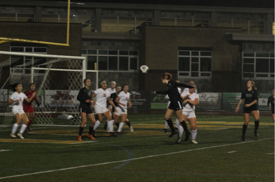 Earning another goal for her team, Abby Schmidt, 11, heads the ball off of a corner kick. In their game against Centennial, three of sevens goals scored were headers. Heading a soccer ball in one of the leading causes of concussions in youth sports, and some players are aware of the risk.
