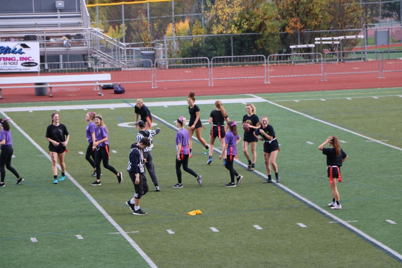 A+penalty+flag+is+thrown+against+team+Black.+The+Purple+team+gets+a+free+10+yard+lead.