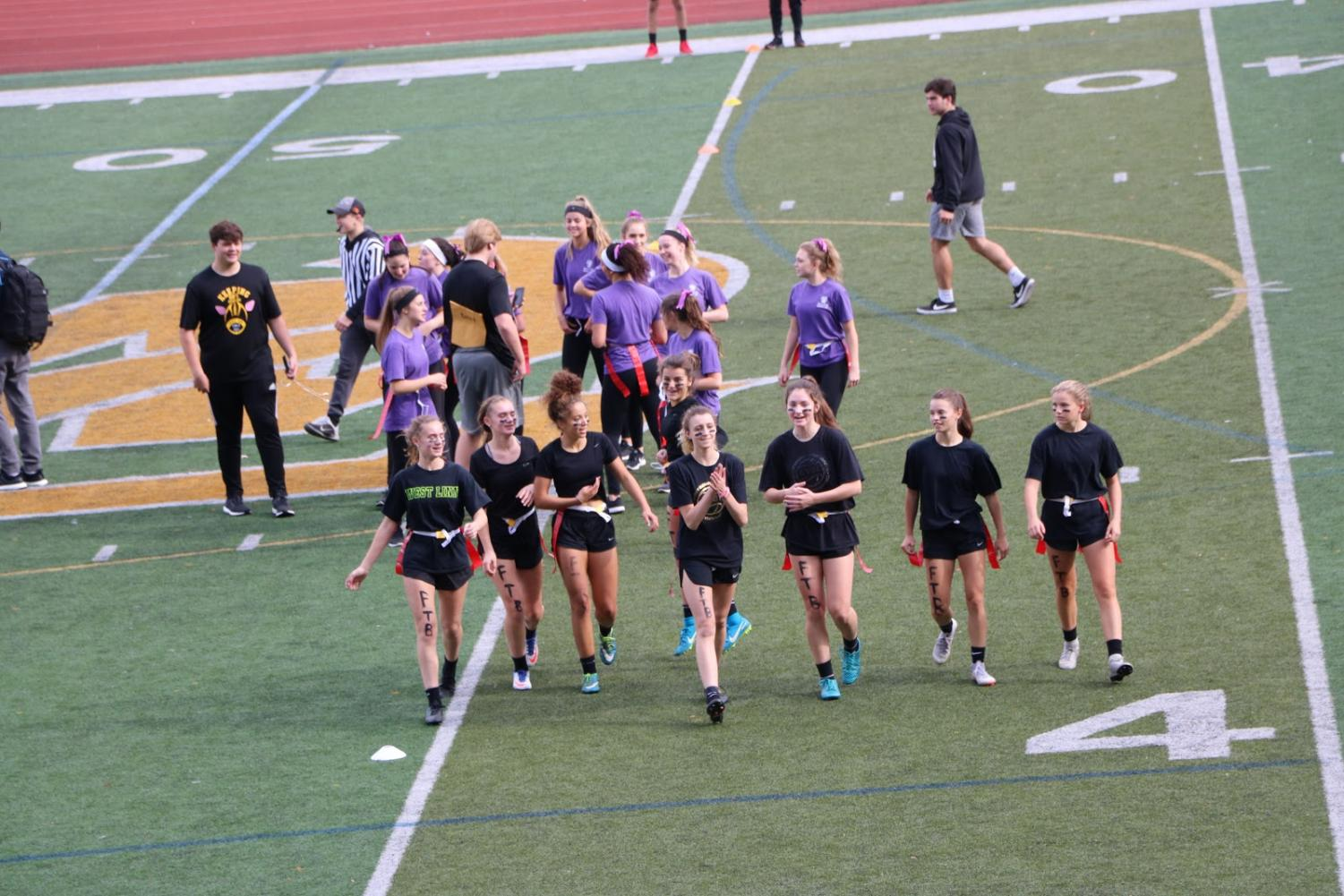 Reigning+victorious%2C+team+Black+jogs+off+the+field.