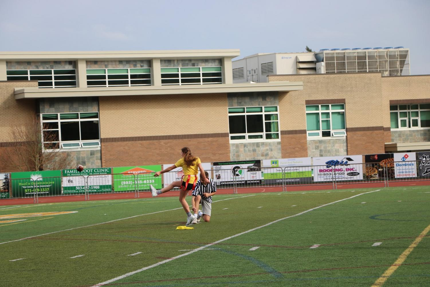 A+player+on+the+yellow+team+attempts+a+field+goal+kick+in+hope+to+score+a+few+extra+points+for+her+team.