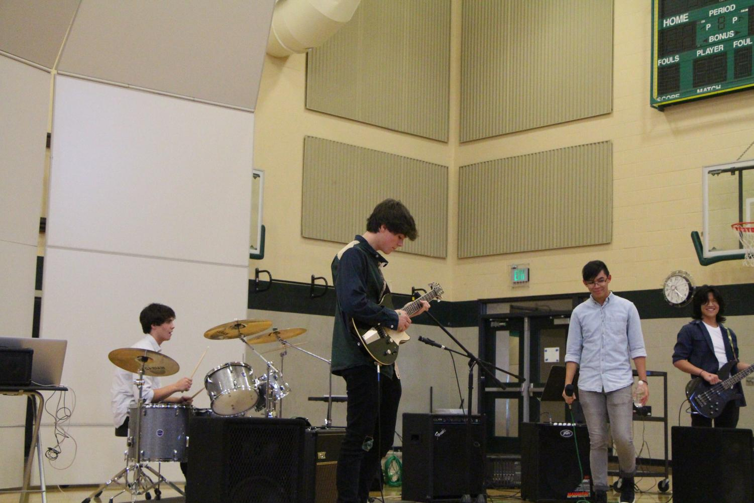 """Peripheral Flow performs covers of """"Island in the Sun"""" by Weezer, """"Someday"""" by the Strokes and more. The band features juniors Jackson Monahan, Daniel Monahan, Matt Chao and Wilfred Lim."""
