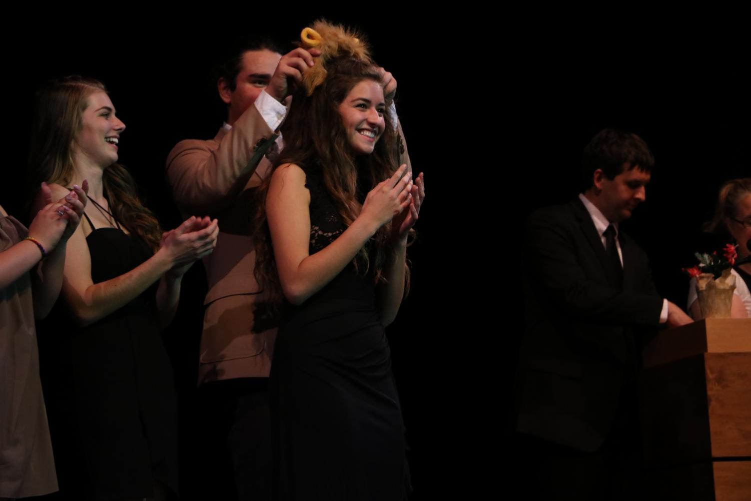 At the end of the pageant on Nov. 20, senior Faith Varga accepts the lions ears for Ms. West Linn. Varga was one of 11 students who raised over $2,900 for Clackamas County Coalition for Suicide Prevention.