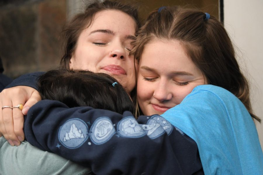 Gigi Schweitzer and Ahna Schaper, juniors, share an embrace.