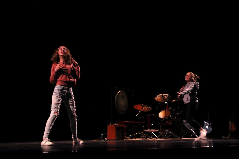 Maddie+Meyers+and+Kaydence+Miekle%2C+freshmen%2C+do+an+interpretive+dance+to+a+Bardic+poem+reading.