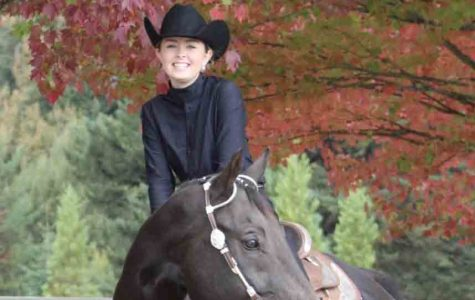Kristen Epperson, sophomore, with her horse Rocky.