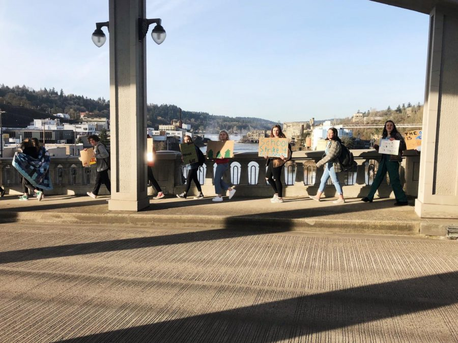 At 9 a.m., protesters march across the Oregon City Bridge.