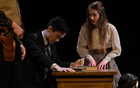 Lord Angelo and Isabella (Philip Chan, senior and Ashley Yablonsky, junior) arguing over the fate of Claudio.