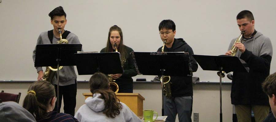 Sharing+music+with+the+class%2C+Kathleen+Terner%E2%80%99s+advanced+algebra+students+were+allowed+a+break%2C+while+a+group+of+band+students+came+into+class+share+their+music.+Christian+San+Nicolas%2C+Andrew+Van+Horn%2C+Joshua+Choi%2C+and+Alyssa+Hargis%2C+sophomores%2C+were+preparing+to+compete+for+the+best+high+school+musicians+in+the+state.+As+the+class+absorbed+the+music%2C+Terner+said%2C+%E2%80%9CLooking+around+the+room%2C+not+a+single+person+was+on+their+phone.+That+is+the+greatest+gift+you+could+receive+now+a+days.%E2%80%9D%0A