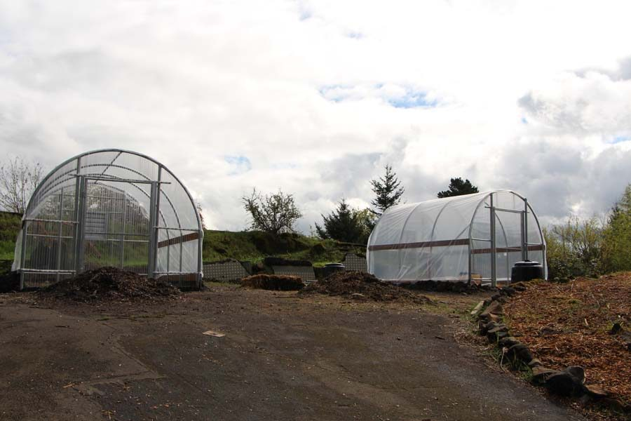 Fount view of both greenhouses
