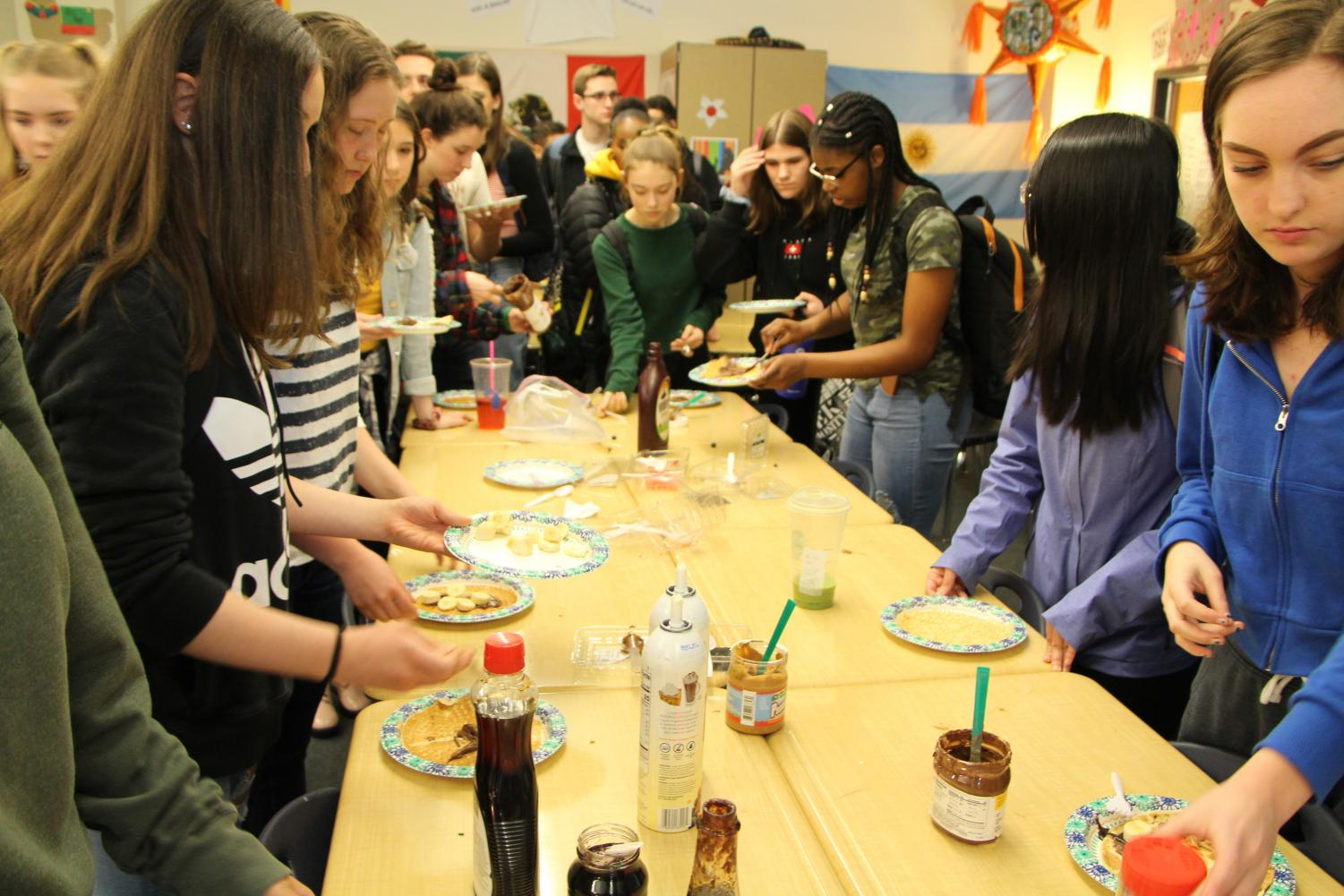Students+create+their+crepes+with+a+variety+of+ingredients.