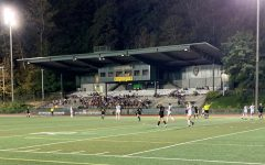 The floodlights illuminated the stadium on opening night, where the Lions would go on to beat McMinnville.