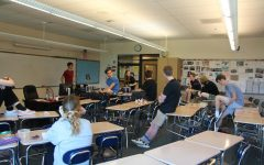 JSA club members debate about how much, if at all, the government should pay for citizens' medical bills.
