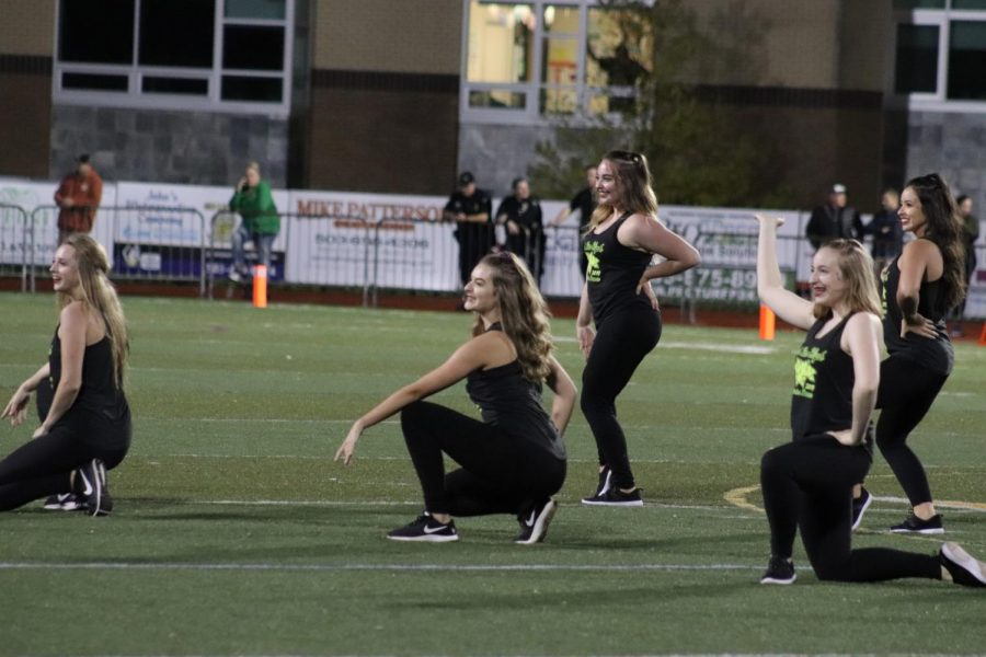 Debutantes dancing during halftime.
