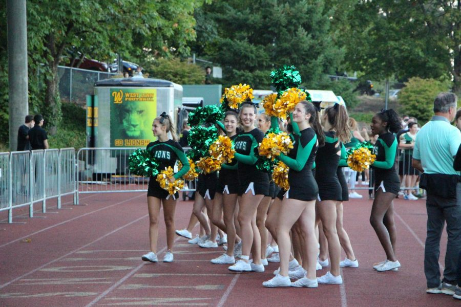 Cheerleaders rally the student section.