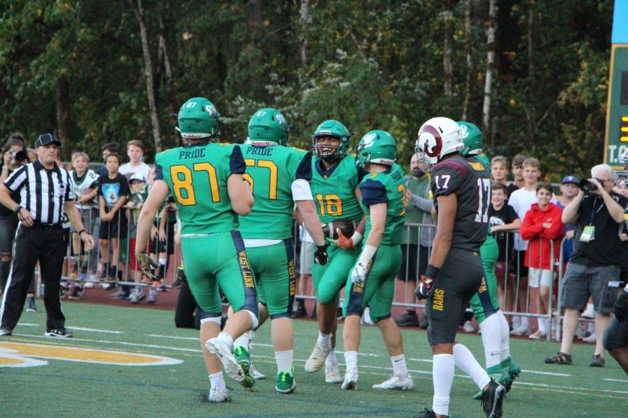 Players celebrate after scoring the first touchdown of the game.