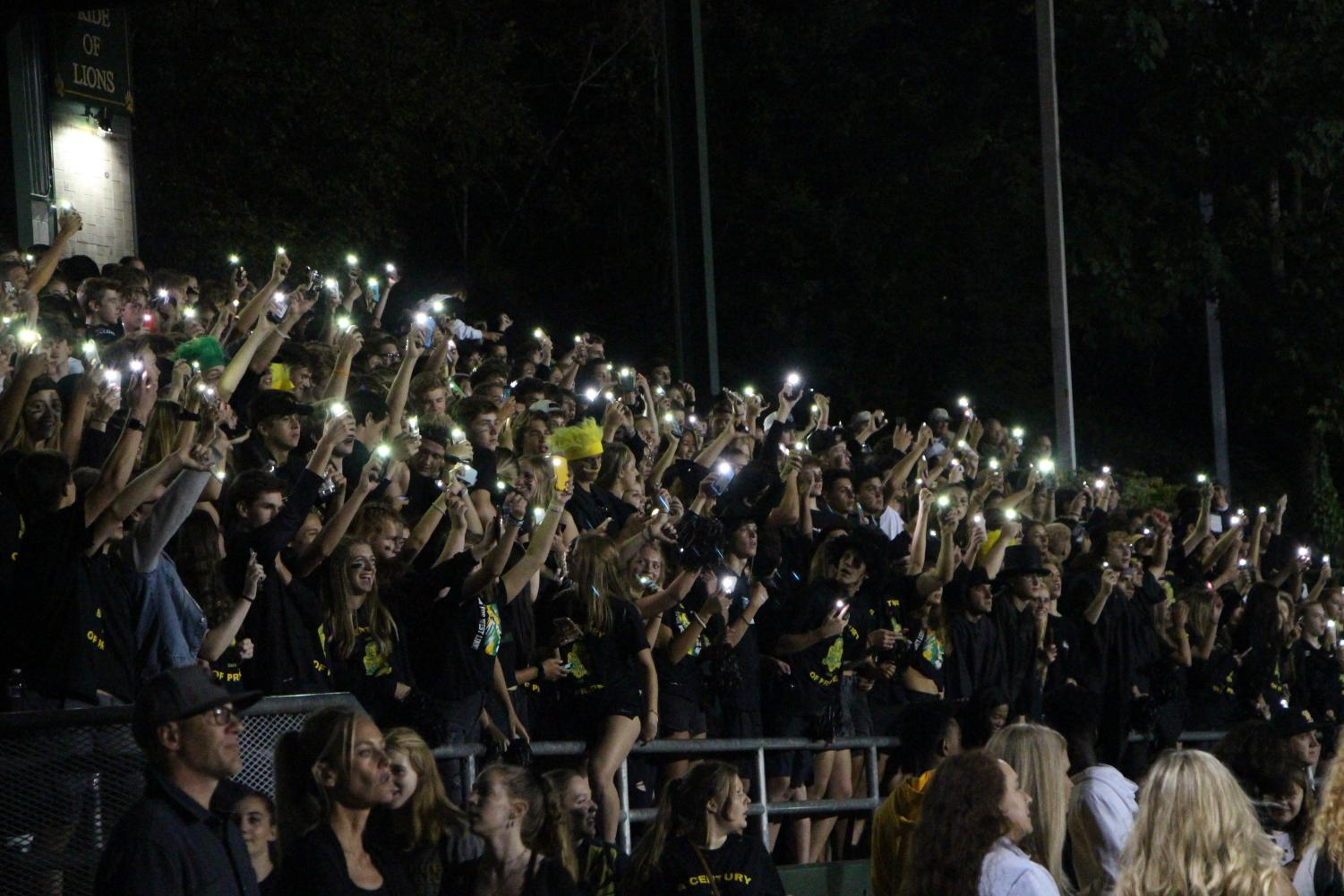 Students+show+support+with+both+cheers+and+their+phones.+
