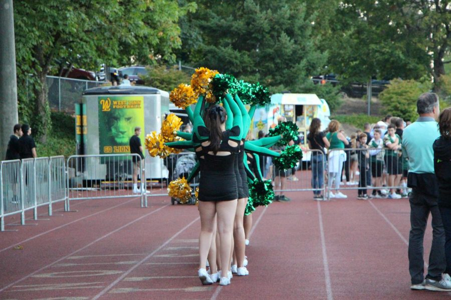 Cheerleaders add a twist to the National Anthem.