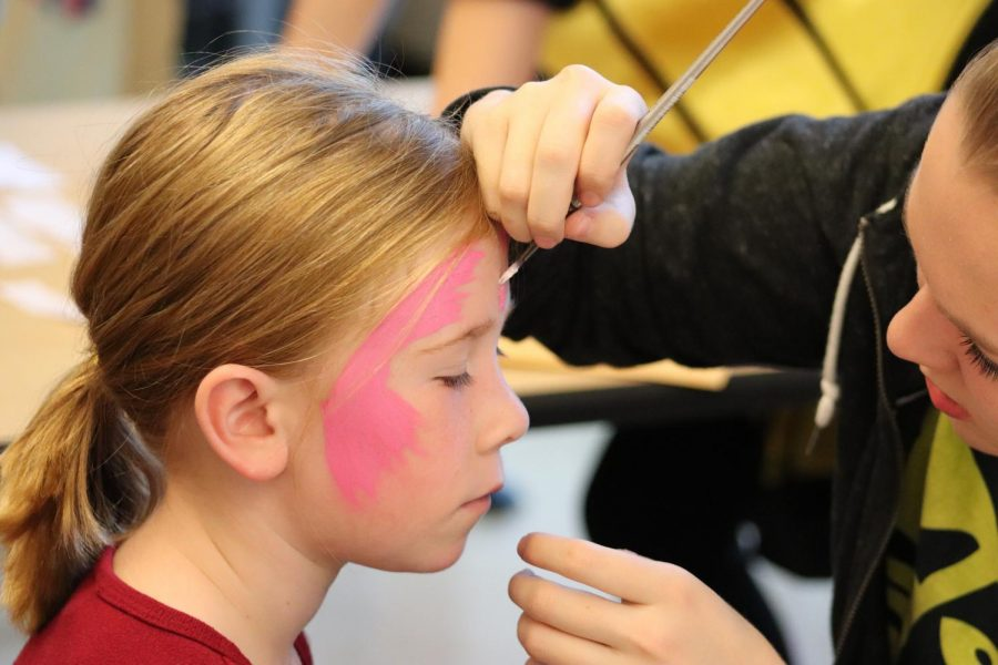Kids+are+seen+with+face+paint+walking+around.
