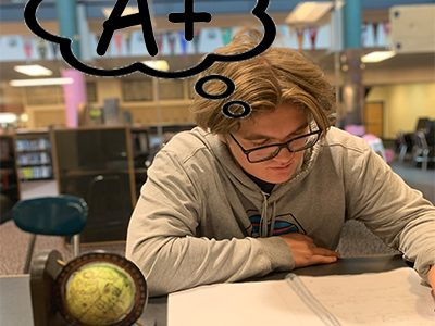 Thor Severson, junior, studies in the library for an upcoming test.
