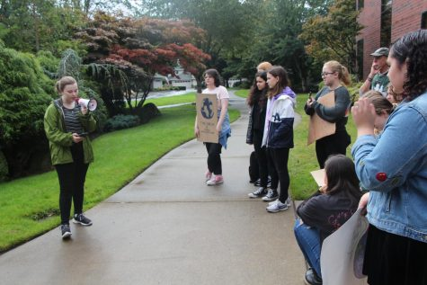 West Linn protesters gather while Nikki Rudnick, senior, talks about her fears on climate change.