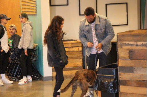 Leadership at its finest. Youth pastor Scanlon and his dog Elton converse with a student. Danye and all of the other leaders are there at the Summit every week, ready and available to converse with students.
