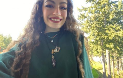 Angelic Tosado, senior, models some of the necklaces she has made. Tosado created her jewelry business, Newmoon Jewelry, shortly after Oregon's shelter-in-place order was first issued.