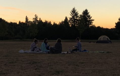 As the sun peeks over the horizon, seniors reconnect with their peers and absorb the scenery.