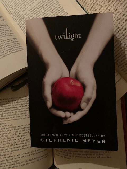 'Twilight' tells a story of a girl trapped between two worlds, the real one and the one of the boy she loves.